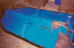 Painting the top-side of the 1972 VW Beetle chassis.