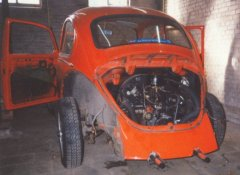 Removing the rear deck-lid from the 1972 VW Beetle.