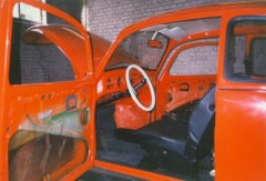Removing the interior from the 1972 VW Beetle.