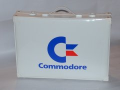 A briefcase with the Commodore logo.