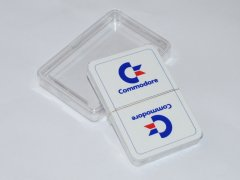 A set of playing card with the Commodore logo.